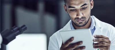 Man holding a tablet inside medical lab