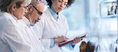 three doctors analyzing data