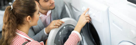Young couple shopping for dryer