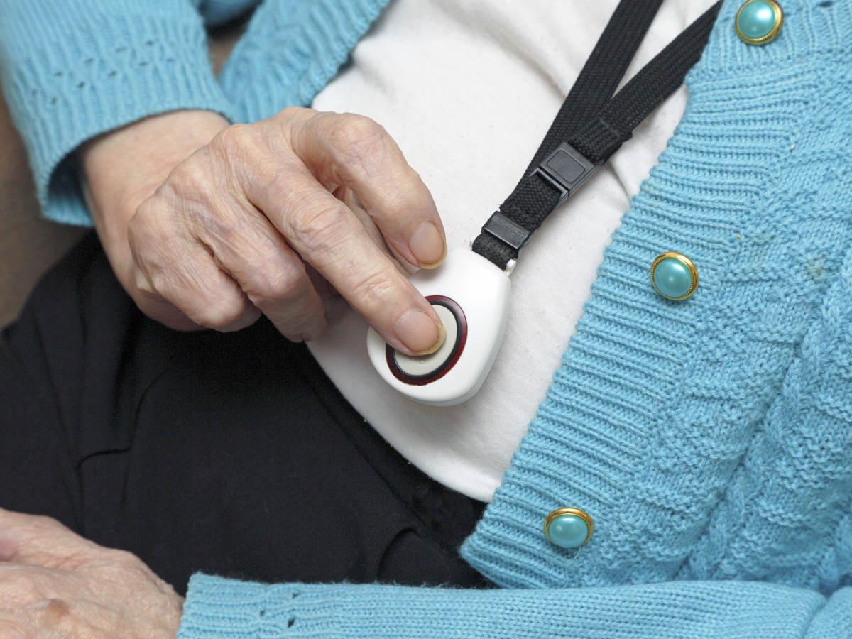 Senior citizen using emergency call button