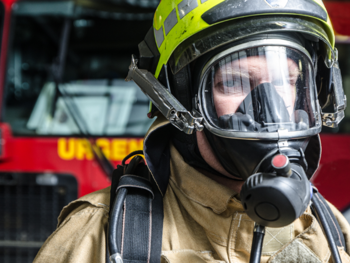 Fire fighter wearing protective equipment and face shield