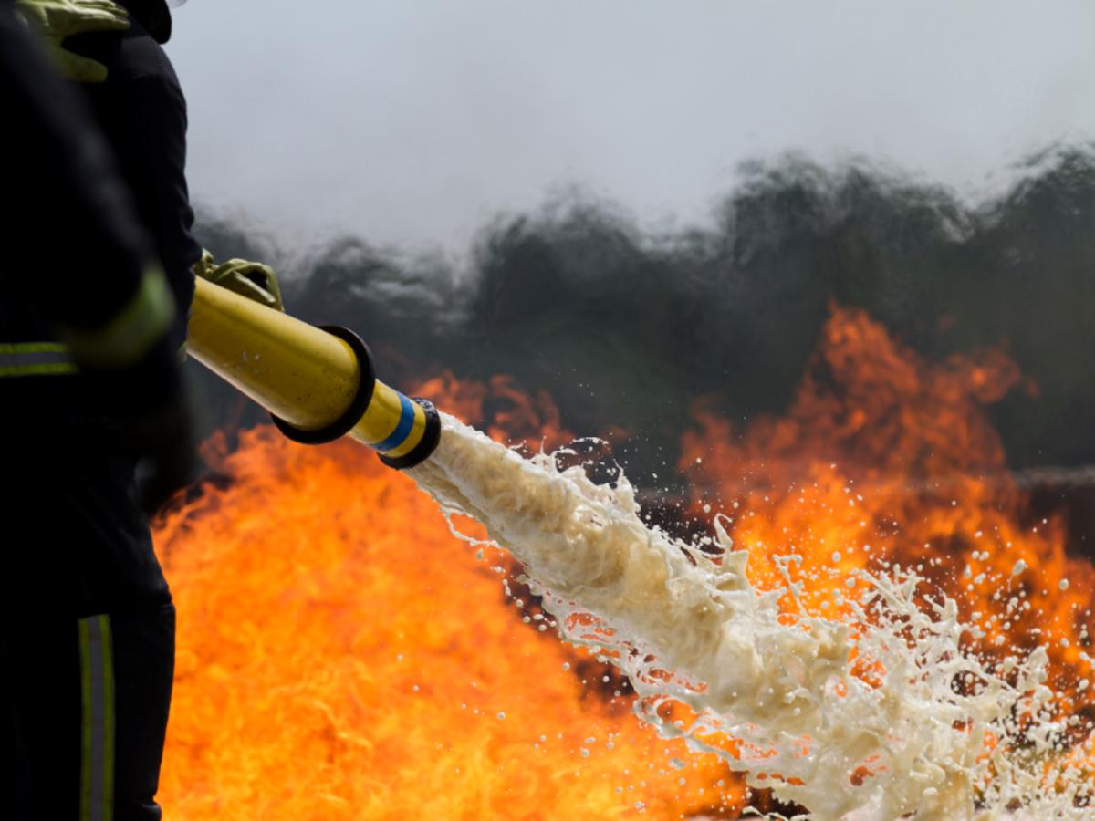 Fire hose spraying fire