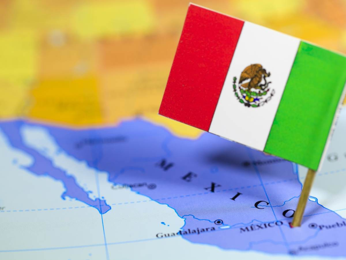 Picture of the Mexican flag fixed in Mexican country on a world map