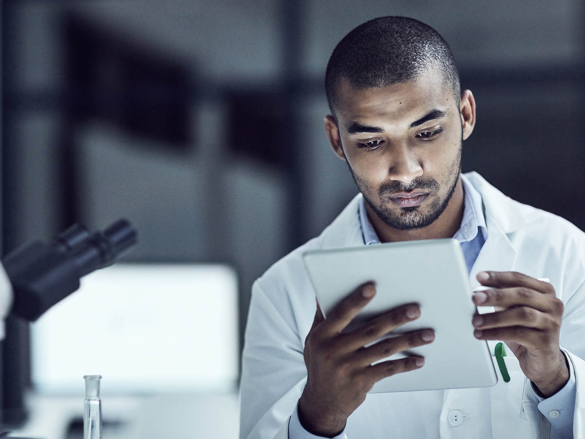 Man holding a tablet inside medical lab