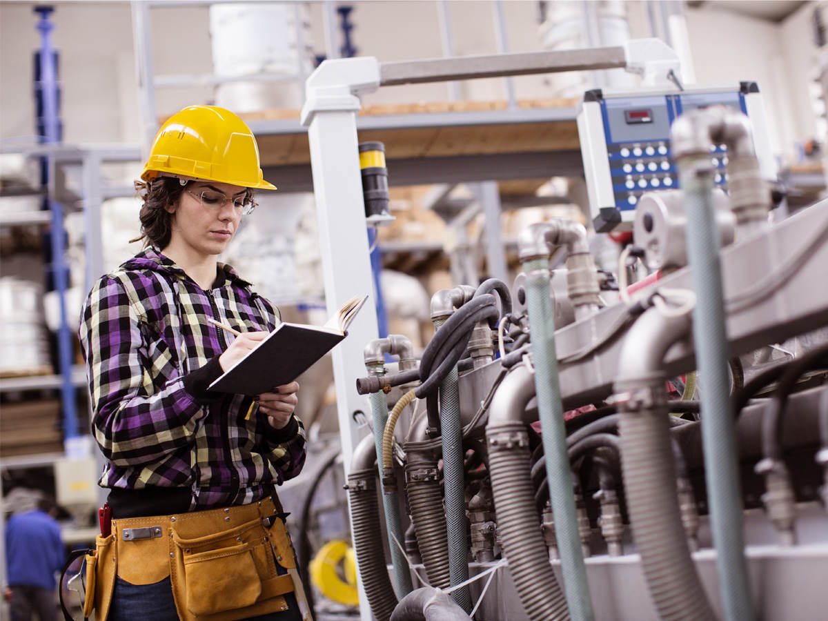 Female Engineer inspecting plant