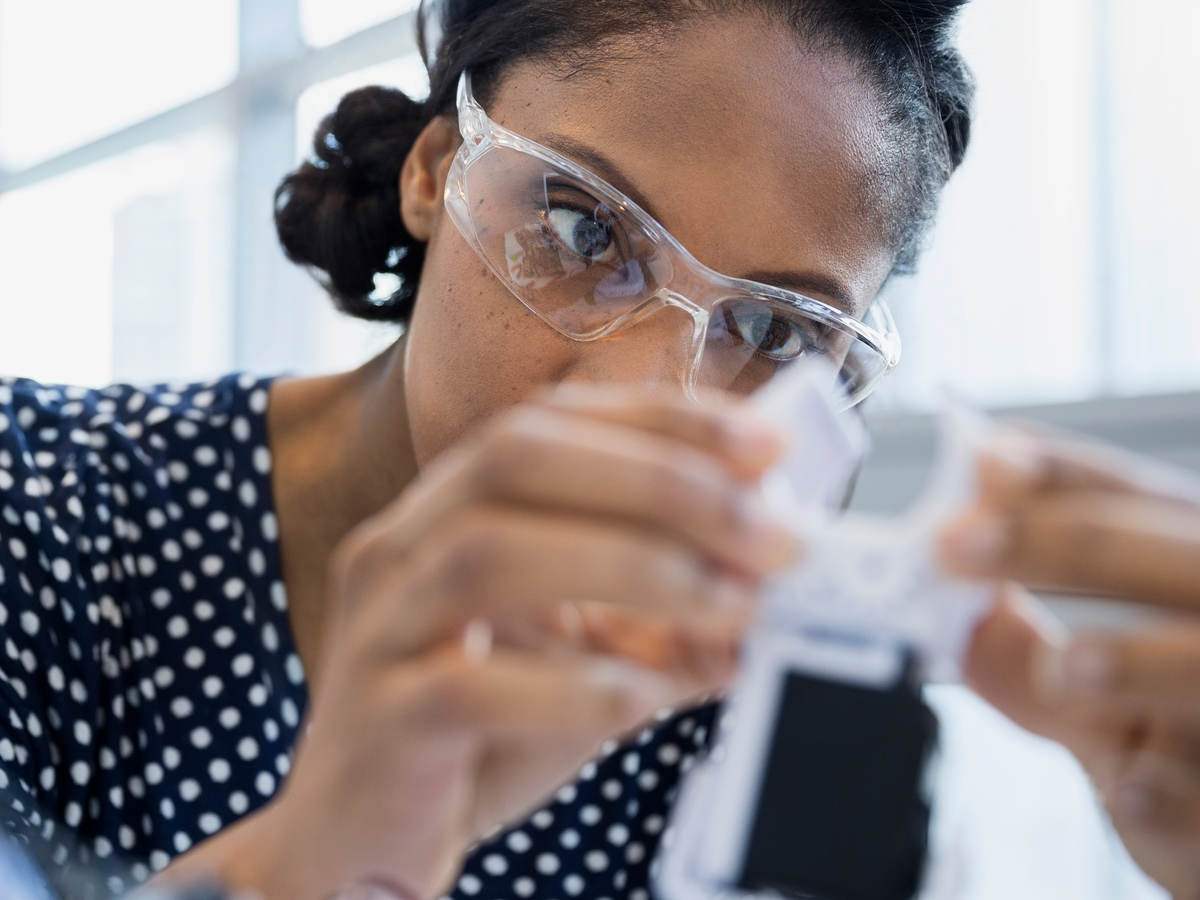 Woman scientist testing a sample