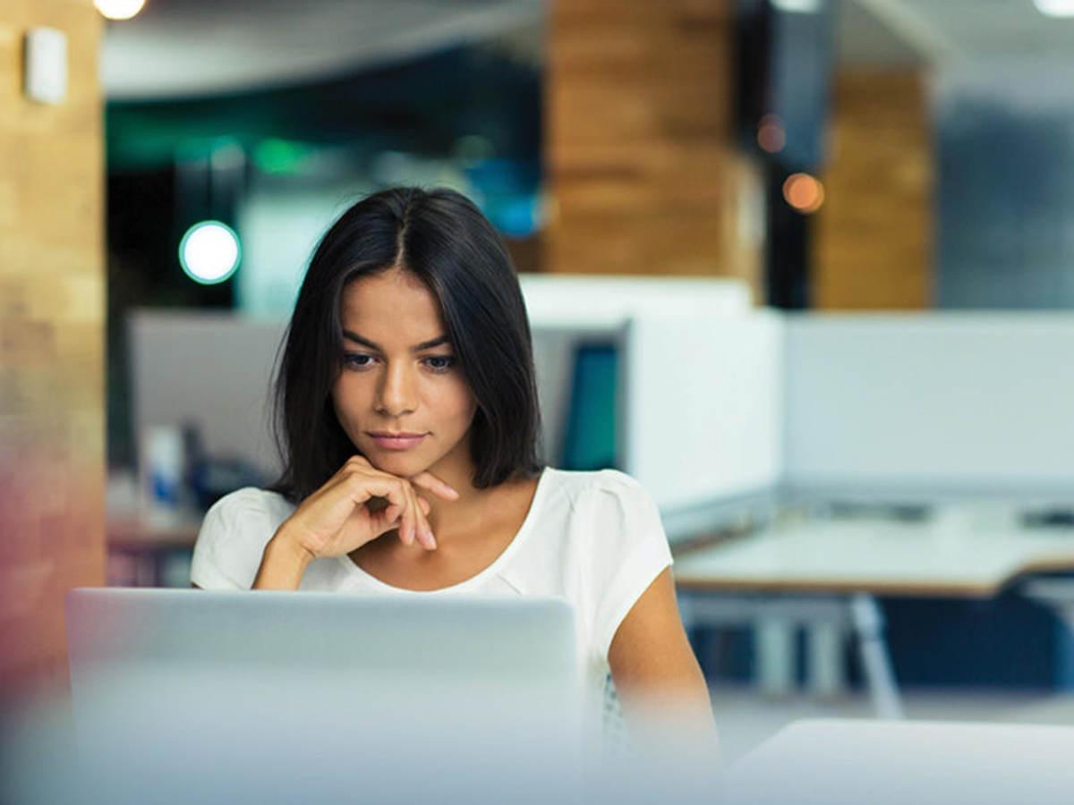 Woman looking on laptop screen